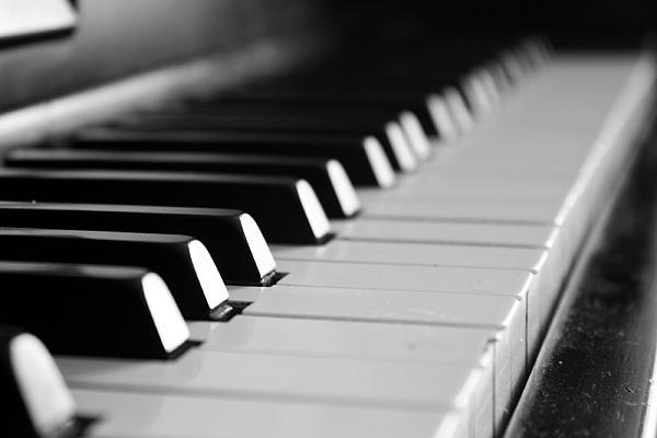 Kim & Company - A close up of a piano - Piano